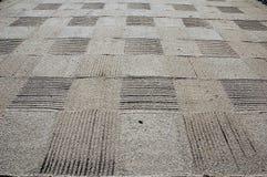 Sand checkerboard Stock Photos