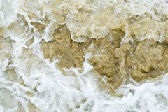 Sand churned by rough seas Stock Photos