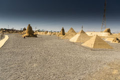 Sand City Hurghada. Some of the many sculptures made of sand near the town of Hurghada Egypt. The Pyramids of Giza are depicted here in the near foreground stock photography