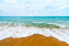 Sand clean beach and sea waves Stock Photos