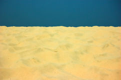 Sand and clear sky. Yellow sand and blue clear sky royalty free stock image