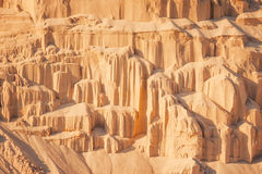 Sand cliffs in industrial quarry background Royalty Free Stock Images