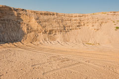 Sand cliffs in industrial quarry background Royalty Free Stock Photography