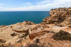 Sand cliffs shore Algarve Portugal Stock Photos