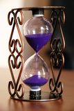 Sand clock. On desk closeup, time passing concept stock image