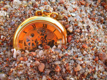 Sand and clock. An old clock in the sand of a beach royalty free stock images