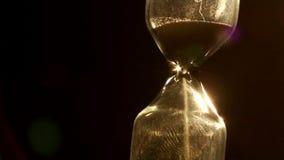 Sand clock. Glass sand clock in the dark stock footage