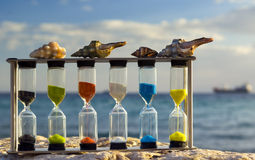 Sand-clock and marine shells. Sand-clock and shells are symbolyzing a fragility of marine ecosystems of the Red Sea stock photos