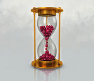 Sand clock and pink heart Royalty Free Stock Images