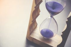 Sand clock on table. Sand clock on the wooden table Royalty Free Stock Images