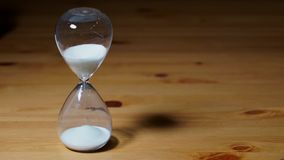 Sand clock with white sand stock video