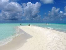 Sand and Clouds of Maldives. A cloudy maldivian blue sky with a tongue of sand in the sea Stock Photo