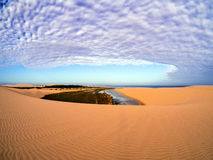 Sand and clouds stock image