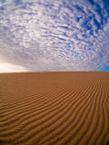 Sand and clouds royalty free stock photography
