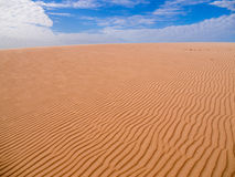 Sand and clouds royalty free stock photos