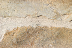 Sand color stone tiles on the wall Stock Images