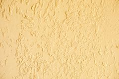 Sand color textured plastered wall. Fresh otvetka in commercial premises, designer renovation in the house.  royalty free stock photography