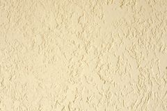 Sand color textured plastered wall. Fresh otvetka in commercial premises, designer renovation in the house.  stock images