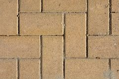 Sand Colored Brick Stone Pavement on The Ground for Street Road. Sidewalk, Driveway, Pavers, Pavement in Square Pattern Texture Ba stock images