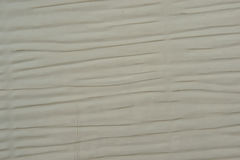 Sand Colored Siding. Closeup of horizontal sand colored building siding Stock Photo