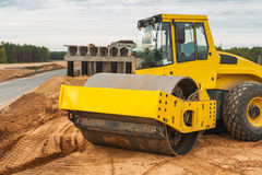 Sand compactor on pile of sand Stock Image