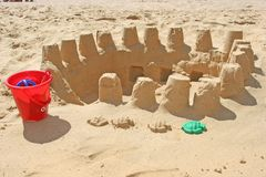 Sand construction. S of several sand castles with a bucket and snall sand form Royalty Free Stock Photo