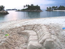 Sand couch at beach. A huge sand scuplture of a couch at a resort area, in Singapore Royalty Free Stock Image