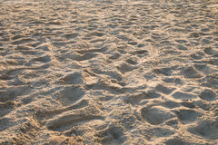 Sand crest on the beach at sunset. Several small waves wide area Stock Photography