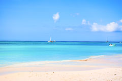 The sand and the crystal sea water of the Saona island, with som Royalty Free Stock Photo