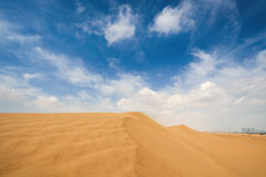Sand desert and city Royalty Free Stock Photography