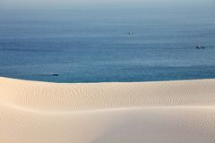 Sand desert dunes and sea Royalty Free Stock Images
