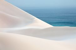 Sand desert dunes and sea Royalty Free Stock Photo
