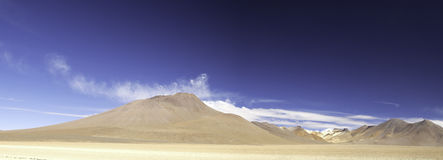 Sand desert and mountains in andes Bolivia Royalty Free Stock Image