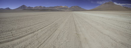 Sand desert and mountains in andes Bolivia Stock Photography
