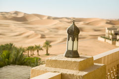 Sand desert, oasis, with arabic buildings and lamp Stock Images