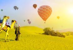 Sand desert safari Camel Bedouin. Tourist attractions Hot Air balloons flying adventure sunset sand desert safari camels in the Dubai, Tourists are taken on stock image