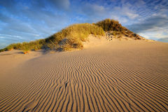Sand desert during sunset in the Slowinski National Park in Poland. Stock Photos