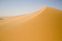 Sand desert, and a yellow dune weave Royalty Free Stock Photo