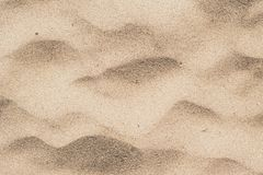 Sand in the desert. Yellow sand with waves on it. stock photo