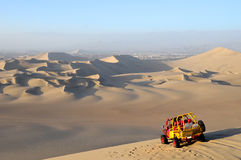 Sand Dessert with Dune Buggy Royalty Free Stock Images