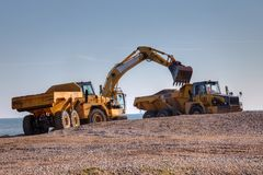 Sand digging Stock Photo