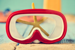 Sand, dive mask and starfish Royalty Free Stock Photo