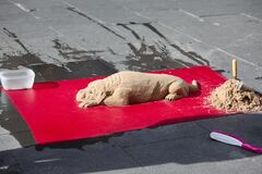 Sand dog sculpture in Rome