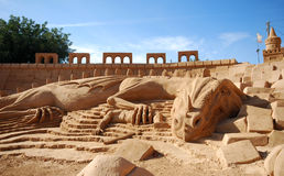Sand dragon. Fantastic dragon sand sculpture (Portugal royalty free stock photography