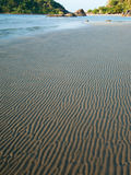 Sand drawings. Marks left by the tide on the beach Stock Photo