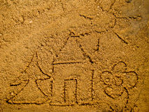 Sand Drawings. Children's draw on yellow sand Stock Images