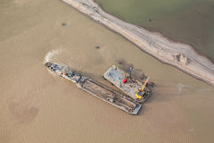 Sand dredger on barge Stock Images