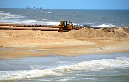 Sand dredger on beach Royalty Free Stock Photos
