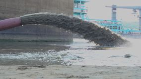 Sand dredging boat. Pipe of sand dredging boat cleaning river bed slow motion stock footage