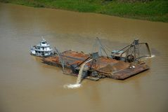 Sand dredging boat royalty free stock images